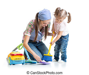 Child girl and mother sweep floor
