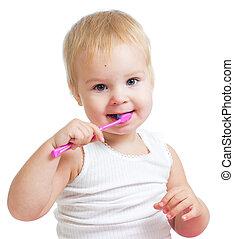 child girl brushing teeth isolated on white