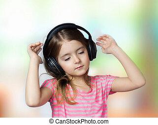 Child girl closed eyes listen music headphones