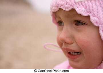 child girl crying close-up outdoor