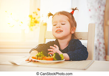 child girl does not like and not want to eat vegetables - ...