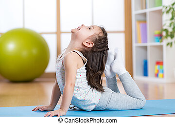 Child girl doing gymnastics