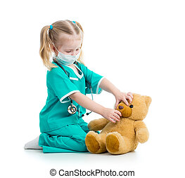 child girl dressed as doctor playing with toy