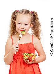 child girl eating healthy food vegetables