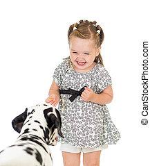 child girl feeding dog