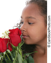 Beautiful Little Princess With Tiara Smelling Roses Over White. Shot with the Canon 20D.