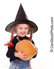 Child girl in costume Halloween witch with pumpkin, broom...