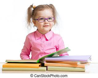 child girl in glasses reading book