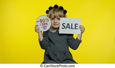 Smiling child girl in school uniform showing Sale word and great purchase discount percentage advertisement inscription, recommending online shopping with low prices on Black Friday. 6k downscale