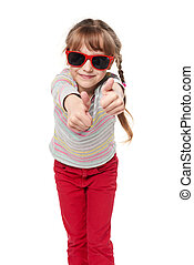 Child girl in sunglasses gesturing thumb up