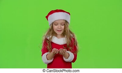 Child girl in the Christmas costumes inflate the stellar...