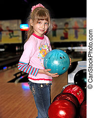 Child girl in with bowling ball. - Child girl in with...