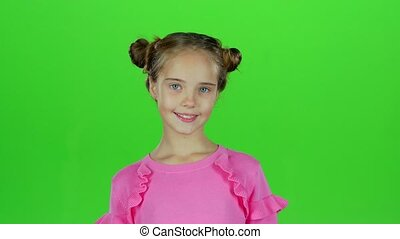 Child girl is making faces. Green screen - Child in a...