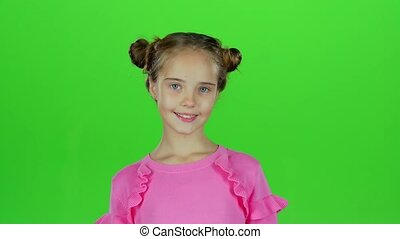 Child girl is making faces. Green screen. Slow motion -...