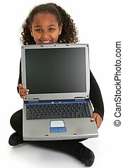 Adorable African American girl sitting on floor with laptop. Shot with Canon 20D.
