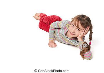 Child girl lying on floor looking away