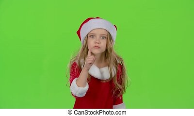 Child girl of the assistant Santa Claus say quietly to their...