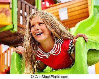 Child girl on playground game.