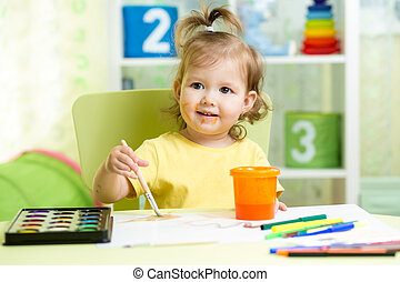 child girl painting at home