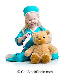 child girl playing doctor with plush toy