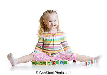 child girl playing on floor at home