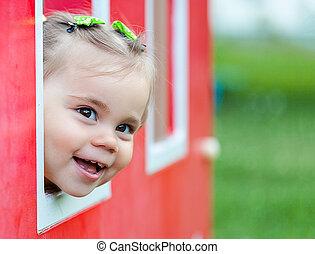 Child girl playing on playground