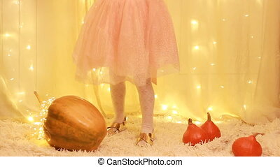 Child girl princess in the dress, in the golden shoes...