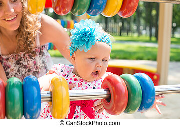 child girl riding train on funfair on summer vacation