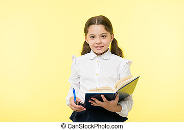 Child girl school uniform clothes hold book and pen. Girl ...
