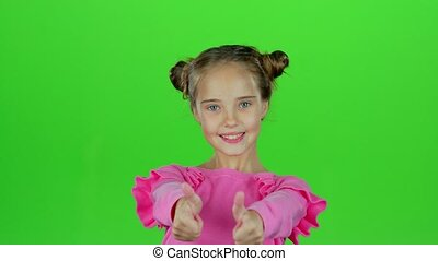 Child girl showing thumbs up and making faces. Green screen...
