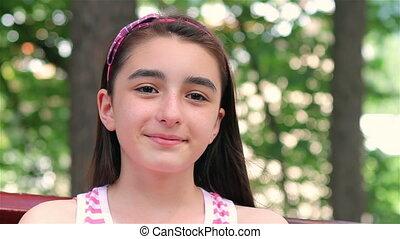 Child girl smiling at camera