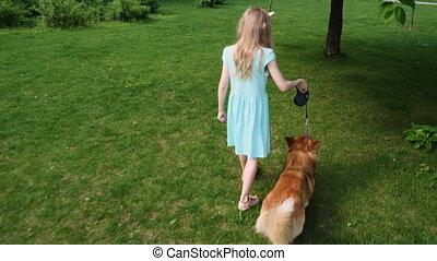 child girl training a dog