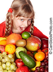 Child girl with group of fruit.