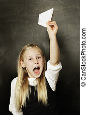Child girl with paper plane - fun!