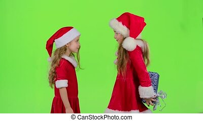 Child gives a New Year gift to her friend. Green screen. Slow motion