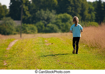 Child goes on a country road.