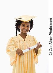 Child graduation. - African American girl in graduation robe...