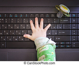 Child hand and computer