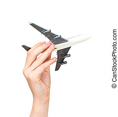 Child hand holding model airplane. Isolated on white.
