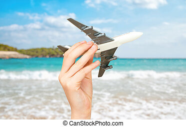 Child hand holding model airplane. Place for text.