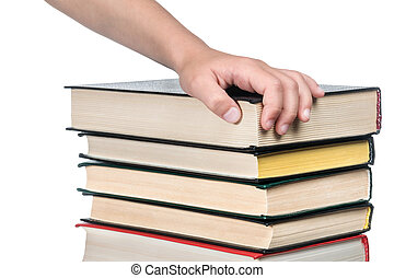Child hand on a pile of books