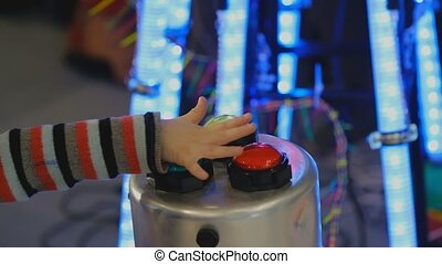 Child hand presses the button - Child hand presses the...
