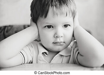 Child hands covering his ears, does not want to listen,  black a