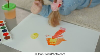 Child hands creating picture with colorful paints - Close-up...