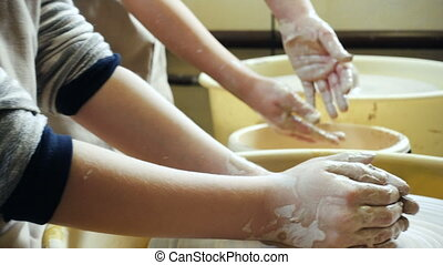 child hands making clay pottery - child hands making a clay...