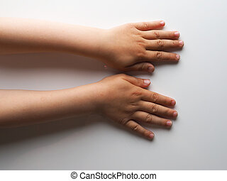 child hands on a gray background