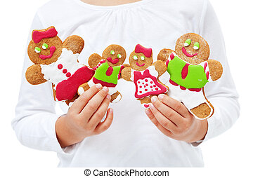 Child hands with happy gingerbread people family
