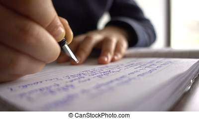 Child hands writing a letter, close up 4K