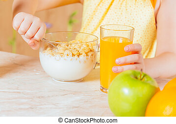 Child has breakfast of cereal flakes