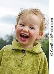 Child has fun - Boy laughs cheerfully